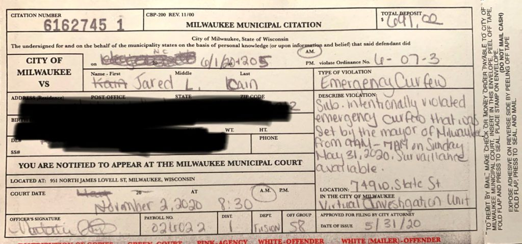 """Jared Cain received this citation from the Milwaukee Police Department, alleging he """"intentionally violated emergency curfew"""" in effect in Milwaukee on May 31, 2020. Cain redacted his address on the citation. He was among at least 170 people cited by city police for curfew violations during social justice protests in late May and early June. Credit: Courtesy of Jared Cain"""