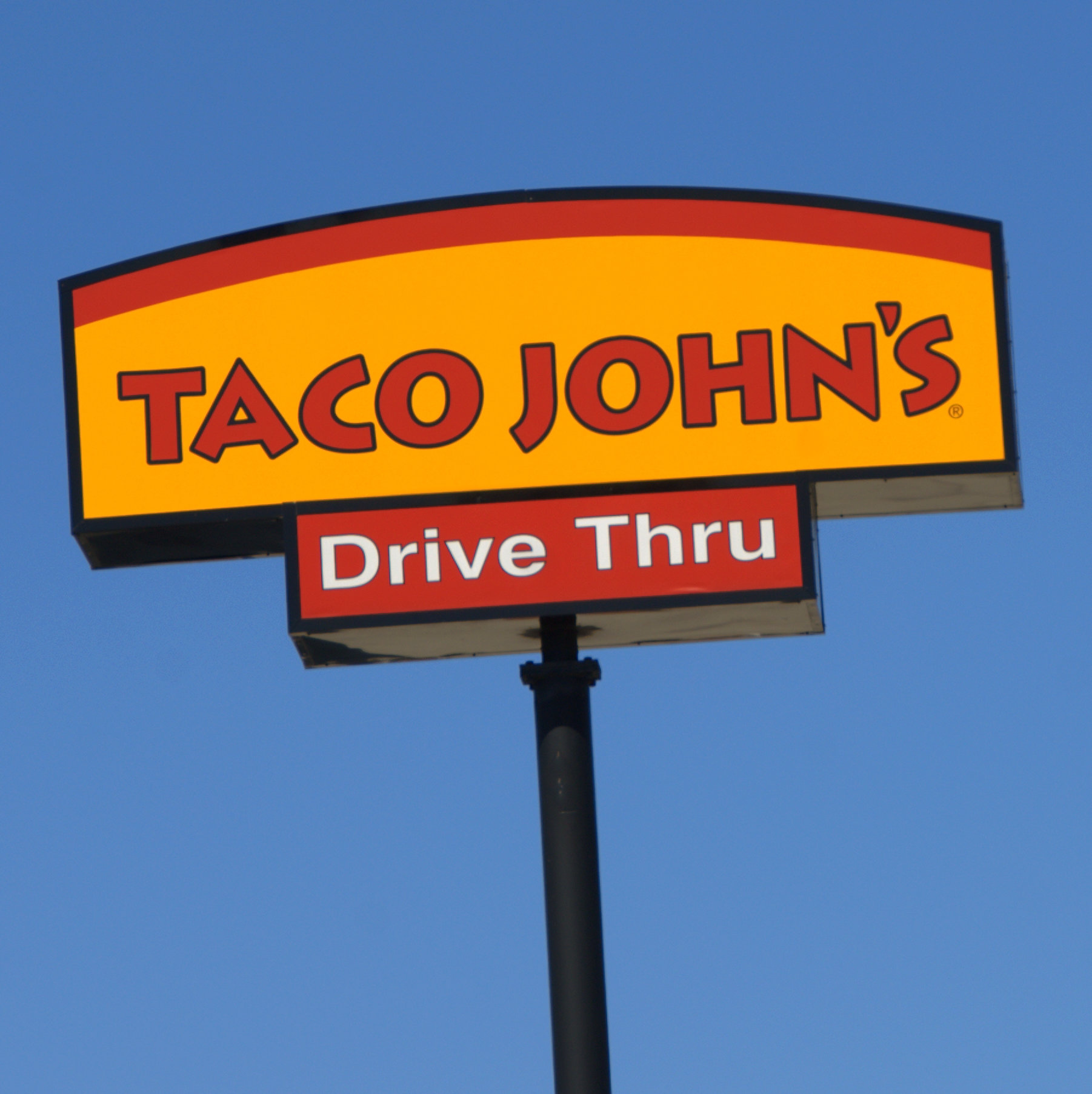 Taco John's sign. Photo by flickr user Mr. Blue MauMau. (CC BY 2.0) https://creativecommons.org/licenses/by/2.0/