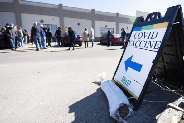 People wait to receive a COVID-19 vaccination Thursday, March 11, 2021, at Hayat Pharmacy in Milwaukee, Wis. Angela Major/WPR