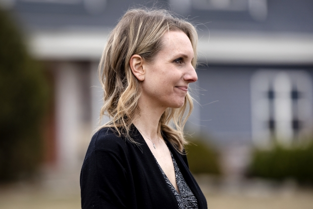 Amanda Maresh stands outside of her home Thursday, March 25, 2021, in Denmark, Wis. She does not plan to receive the COVID-19 vaccine. Angela Major/WPR