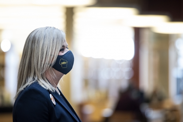 State superintendent candidate Deborah Kerr wears a face mask during a visit to the Beloit Public Library on Monday, March 29, 2021, in Beloit, Wis. Angela Major/WPR