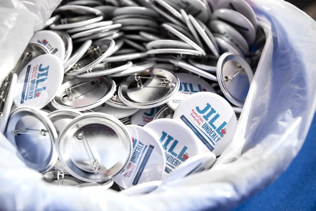 Pins advertising Jill Underly's state superintendent campaign are kept on a table during an event Tuesday, March 30, 2021, at the Waukesha County Democratic Party Office. Angela Major/WPR
