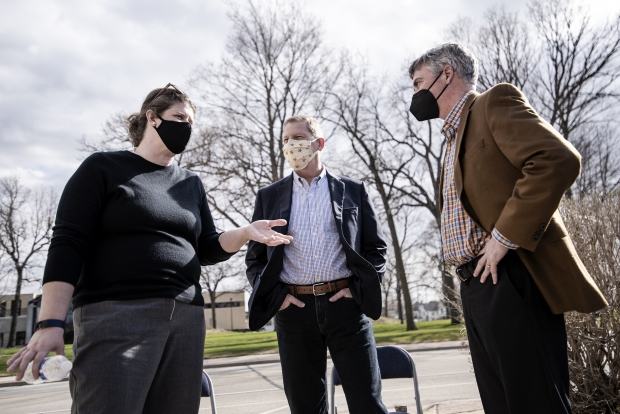 State superintendent candidate Jill Underly, left, speaks with former congressional candidate Tom Palzewicz, center, and Judge Jeff Davis, right, a candidate for Wisconsin Court of Appeals, on Tuesday, March 30, 2021, during a campaign event in Waukesha, Wis. Angela Major/WPR