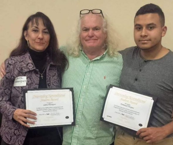 """Laura Manriquez (left) receives the """"Outstanding Nontraditional Student Award"""" with her son Emmanuel Vasquez in 2016. In the middle is Jimmy Johnstone, a now retired adviser at UW-Milwaukee. Photo provided by Laura Manriquez/NNS."""
