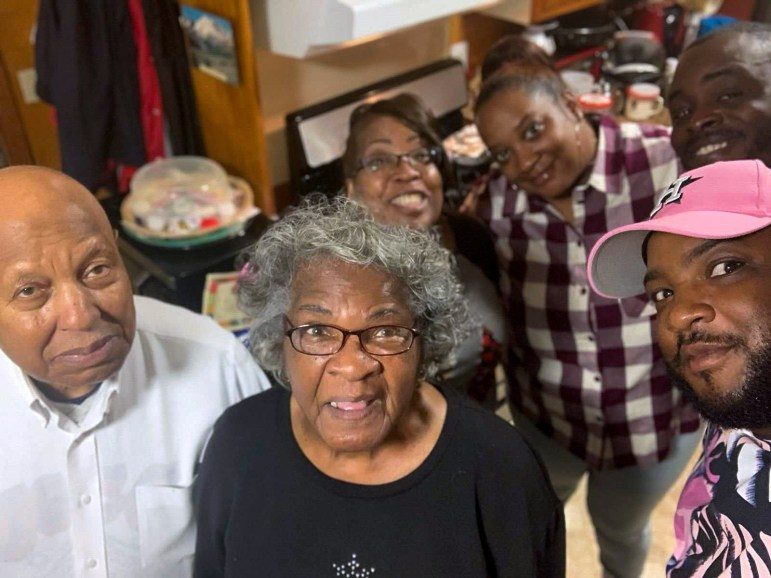 The Fuller family, back left, Arva, and her daughter Paege, and her son (not pictured) are three generations living under one roof in Mississippi. They spent a year worrying that one person could catch the coronavirus and share it with Paege's grandparents who live nearby, Willie and Mildred Belt, at left. Credit: Courtesy of the Fuller family