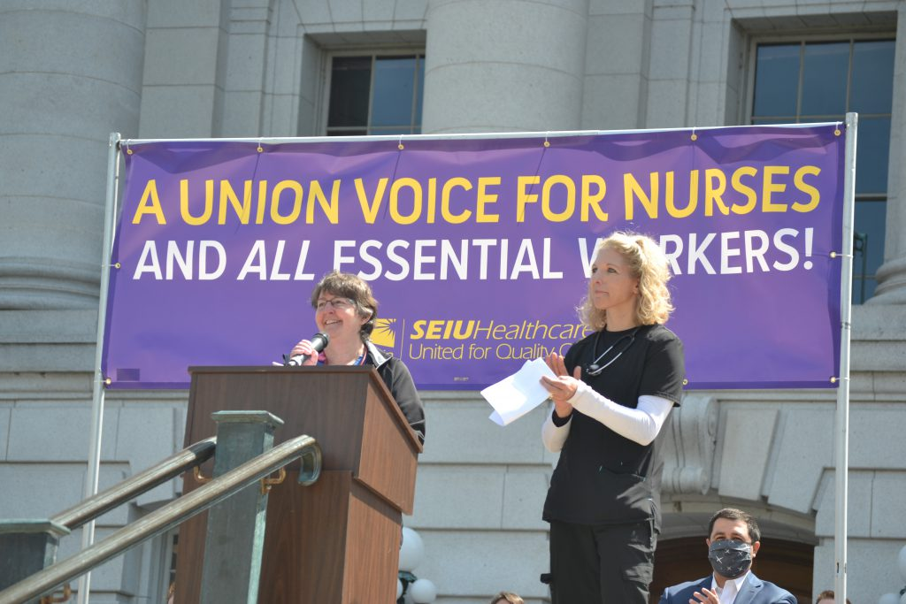 Carol Lemke, RN, left, and Shari Signer, RN, speak at a rally Saturday marking Nurses Week and calling for union representation for nurses and other health care workers. Erik Gunn/Wisconsin Examiner.