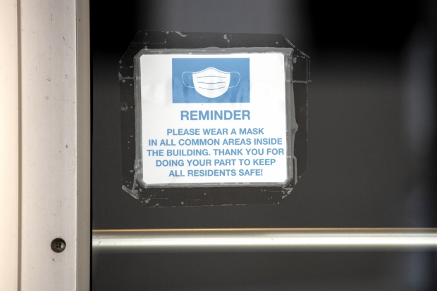 A sign instructs Madison residents to wear a face mask to prevent the spread of COVID-19 on Tuesday, Feb. 23, 2021, in Madison, Wis. Angela Major/WPR