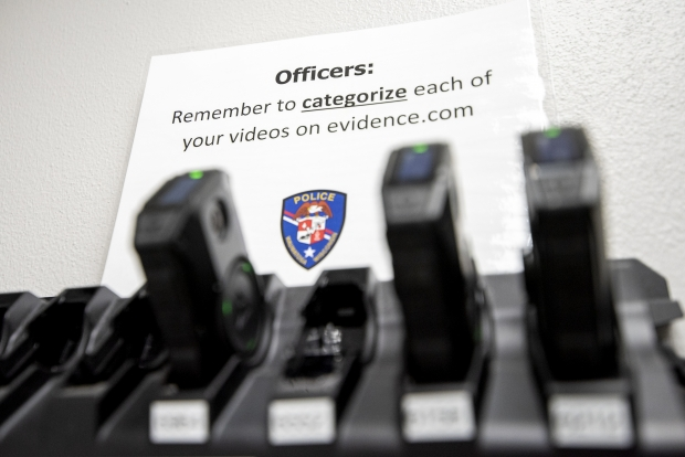 A sign in the Wauwatosa police department reminds officers to categorize videos from the body cameras that are uploaded online on Tuesday, April 20, 2021, in Wauwatosa, Wis. Angela Major/WPR