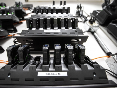 Body cameras are docked onto charging stations Tuesday, April 20, 2021, at the Wauwatosa police department. Angela Major/WPR