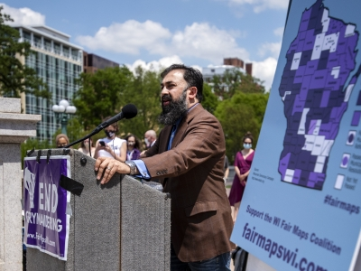 Fair Elections Project director Sachin Chheda speaks to a crowd Monday, May 17, 2021, in Madison, Wis. Angela Major/WPR