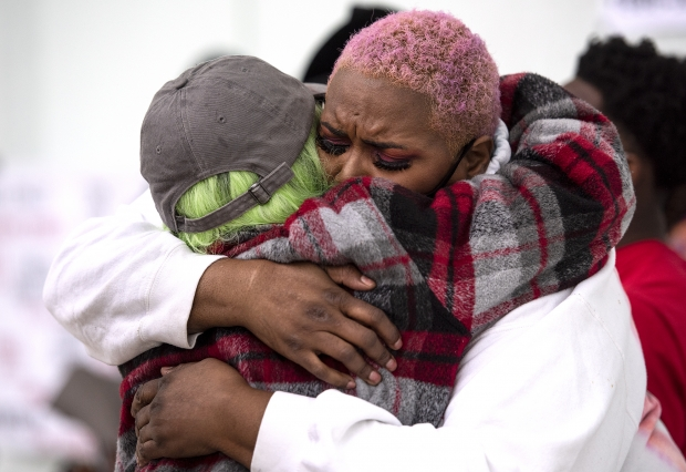Doretha Lock, right, mother of Christopher Davis, hugs Kamila Ahmed after both shared memories and calls to action Sunday, May 23, 2021, in Milwaukee, Wis. Davis was killed by a Walworth County sheriff's deputy in 2016. Angela Major/WPR
