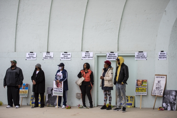 Families attending the event stand in the Washington Park Bandshell as speakers give a call to action Sunday, May 23, 2021, in Milwaukee, Wis. Angela Major/WPR