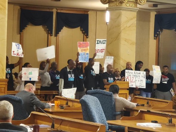 The African American Roundtable, Black Leaders Organizing Communities and other community partners urge city leaders to divest from the police department at a 2019 budget hearing. Photo provided by Markasa Tucker/NNS.