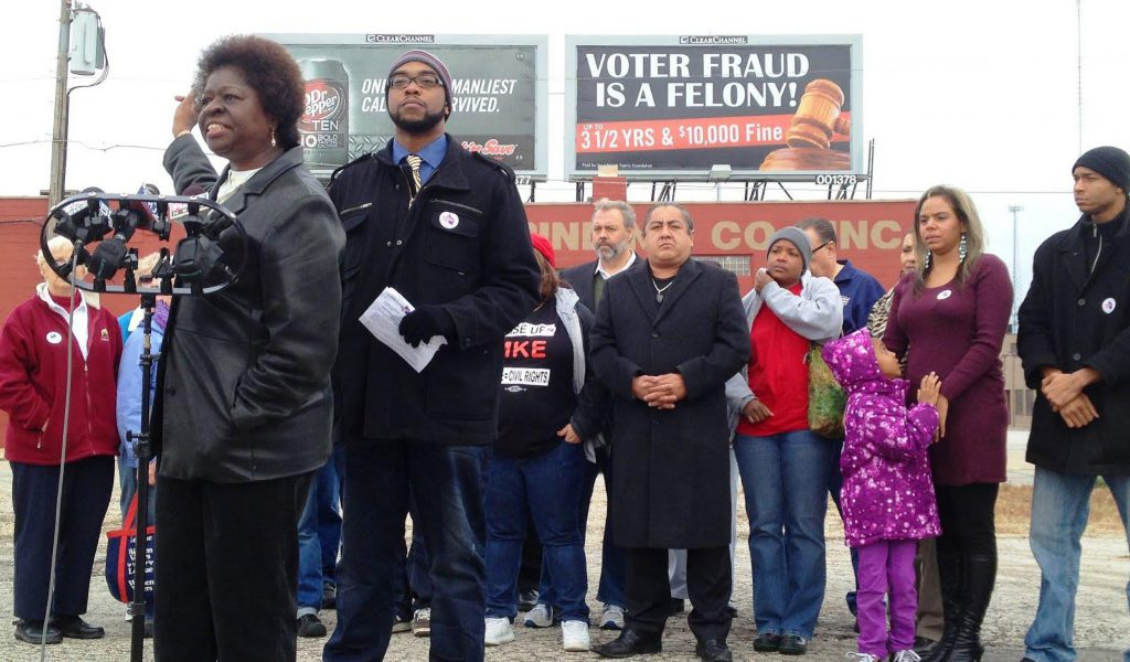 Anita Johnson (left) and Mike Wilder speak at an African American Roundtable-organized news conference about voter suppression in 2012. Photo provided by Markasa Tucker/NNS.