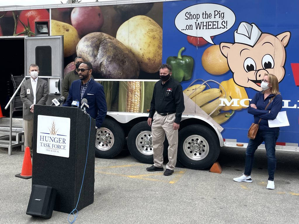 Ascension Wisconsin's Reggie Newson addresses a crowd in front of the mobile market at St. Joseph hospital. Photo provided by Ascension Wisconsin/NNS.