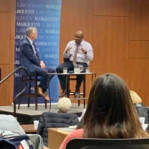 """Moore talks about violence prevention with Mike Gousha during an """"On the Issues"""" forum at the Marquette Law School. Photo provided by Reggie Moore/NNS."""