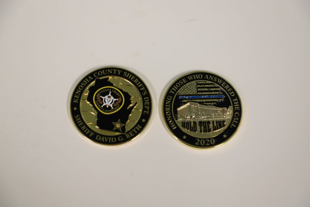 The Kenosha County Sheriff Department's challenge coins, given out by Sheriff Beth. Photo from the Kenosha County Sheriff Department.
