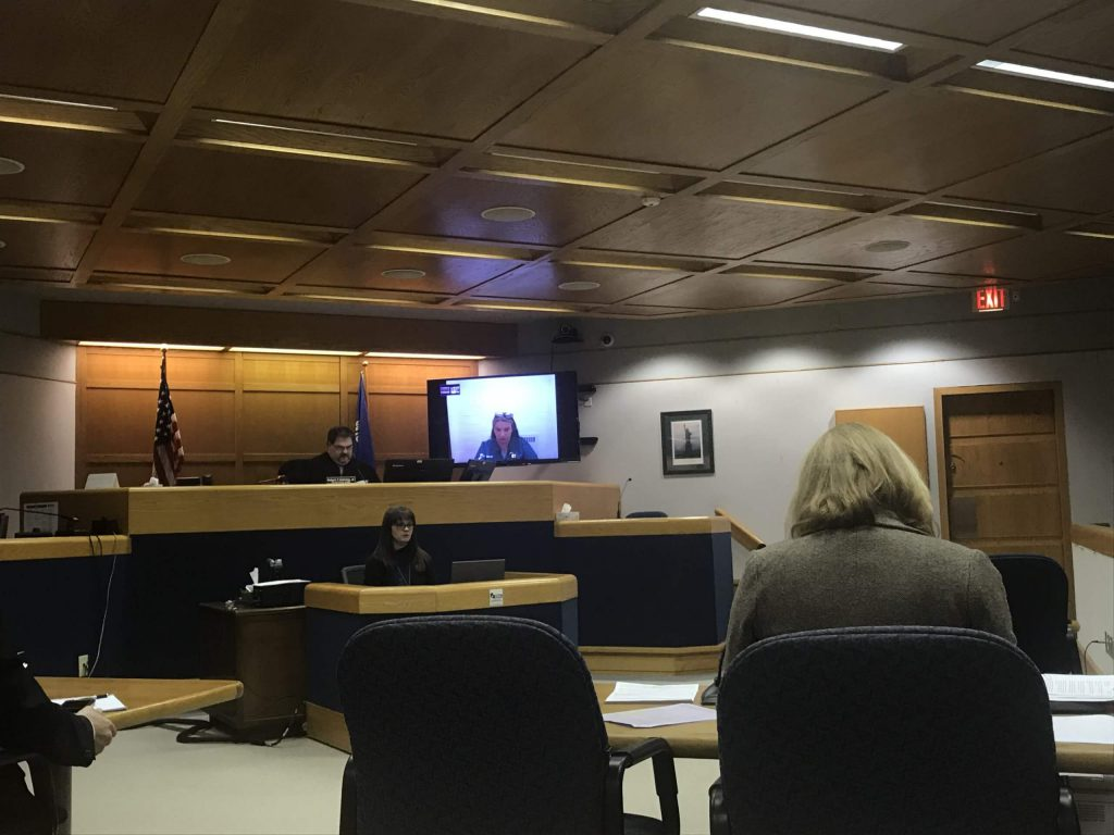 Video-conferencing in a Wisconsin courtroom. Defendants in court cases are increasingly having their day in court remotely. Photo by Henry Redman/Wisconsin Examiner.