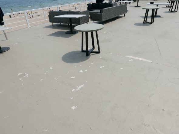 The sealant can be seen here on the concrete floor of the second level of the Bradford Beach Bath House. Photo taken May 20th, 2021 by Graham Kilmer.