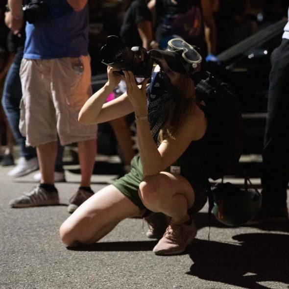 Madeleine Schweitzer kneeling, photography credit to Ryan Berg. Kenosha, Wisconsin, August 24th, 2020.