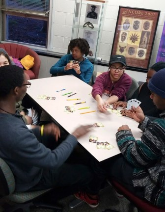 A group of students plays cards in the University of Wisconsin-Milwaukee Black Student Cultural Center in 2019. Student services program manager Victoria Pryor says the BSCC helps UW-Milwaukee students identify grants and scholarships to help them pay for college. (Courtesy of the UW-Milwaukee Black Student Cultural Center)