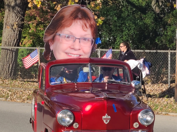 Retiring high school Spanish teacher Meg Graham was the grand marshal of Mukwonago's 2021 parade. Graham, who led the high school's virtual language program this year, appeared as a giant cardboard cutout. Photo courtesy of Meg Graham/WPR.