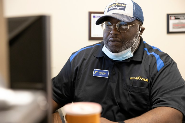 Greg Lewis, who manages a Goodyear tire store in Brookfield, Wis., has tried since January to buy a house in several Milwaukee neighborhoods. He temporarily gave up in late April after repeatedly getting outbid. Particularly disappointing: when he lost the chance to buy a two-bedroom Hampton Heights neighborhood home after a surprisingly low appraisal reduced how much a bank would be willing to lend. He is still working with a real estate agent to eventually buy a house someday. Photo taken April 30, 2021. Credit: Coburn Dukehart / Wisconsin Watch