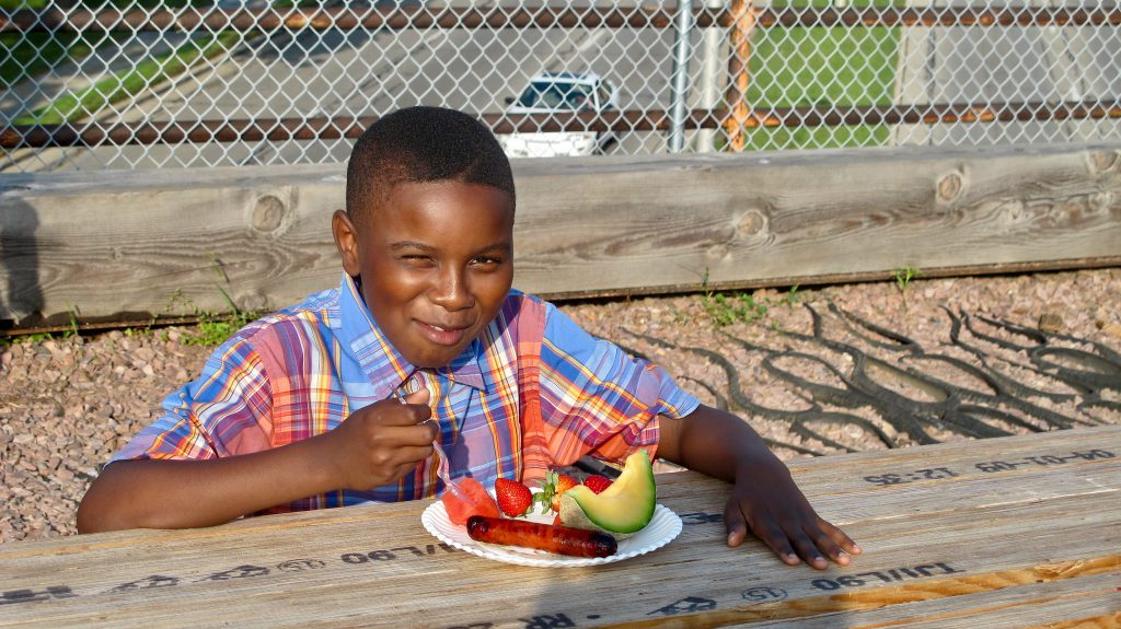 Two new programs will deliver free meals to families with children 18 and younger this summer. This photo is from a community meals event in 2014. NNS file photo.