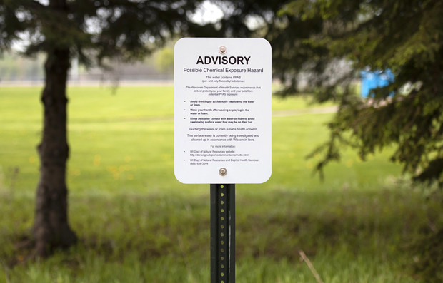 A sign at Marinette High School warns of PFAS contamination in water that runs through the school's campus Thursday, May 20, 2021. Angela Major/WPR