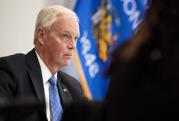 Sen. Ron Johnson sits with people from outside of Wisconsin who claim to have had adverse reactions to COVID-19 vaccines Monday, June 28, 2021, at the Milwaukee Federal Building in Milwaukee, Wis. Angela Major/WPR