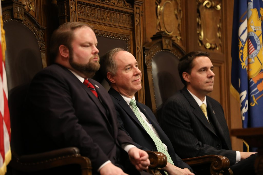 Governor Tony Evers gives his first State of the State address in Madison, Wisconsin, at the State Capitol building on Jan. 22, 2019. He addressed a joint meeting of the Assembly and the Senate. Seen here, from left, are Speaker Pro Tempore Rep. Tyler August, R-Lake Geneva, Assembly Speaker Robin Vos, R-Rochester and President of the Senate Roger Roth, R-Appleton. Photo by Emily Hamer/Wisconsin Center for Investigative Journalism. (CC BY-ND 2.0) https://creativecommons.org/licenses/by-nd/2.0/