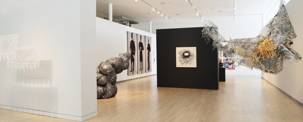 """""""Artists Without Borders: Reflections on Art and Place"""" installation. Photo courtesy of MOWA."""
