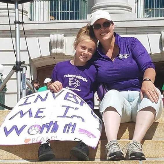 Bailey LeRoy and her mother, Tara LeRoy, participated in a march on the Capitol in June to publicize the funding needs of the state's schools. Bailey is a fifth grader at Palmyra-Eagle Elementary, which has been threatened with closure because of lack of funds. Photo courtesy of Tara LeRoy/Wisconsin Examiner.