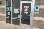 Sign in the window of Taco Stop MKE's Bay View location. Photo by Jeramey Jannene.