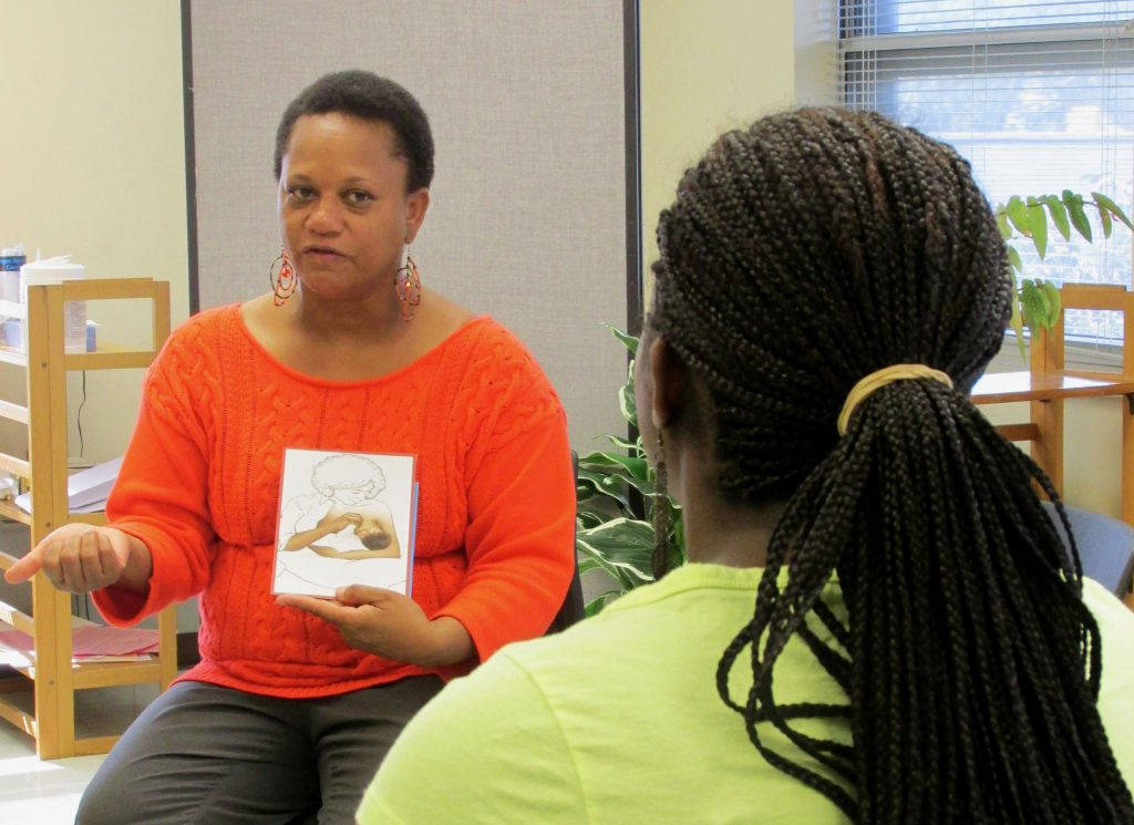 """Dalvery Blackwell, laminitis  of the Milwaukee-based African American Breastfeeding Network, says adjacent    counseling programs let  counselors an accidental   to not """"put women successful  a container  and specify  who and what they are."""" She's shown providing maternity proposal  astatine  the now-closed Marquette Neighborhood Health Center successful  2013. NNS record  photograph  by Kara Cucchiarelli."""