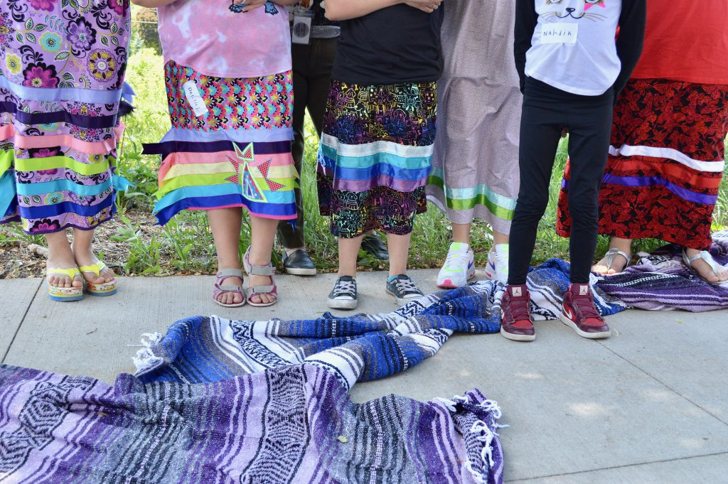 Ribbon skirts correspond  tradition, Elena Romo says, and are an important   portion  of Indigenous culture. Photo by Ana Martinez-Ortiz/NNS.