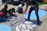 Youths and adults paint murals along several North Avenue crosswalks Saturday as part of a project to raise awareness about reckless driving in the community. Photo by Edgar Mendez/NNS.