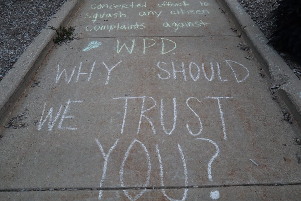 Protesters marked the ground outside the Wauwatosa City Hall with chalk displaying a variety of messages. Photo by Isiah Holmes)/Wisconsin Examiner.