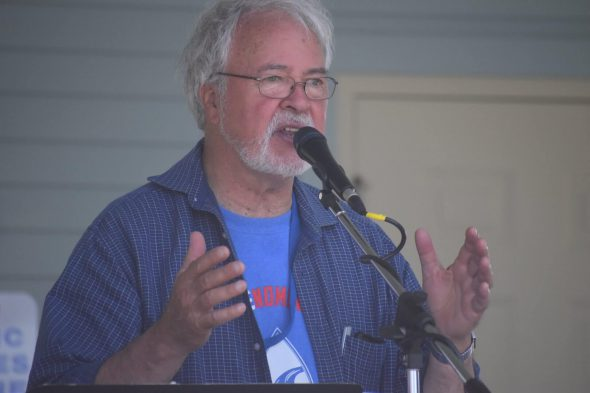 Dale Burie, president   of Coalition to SAVE the Menominee River, speaks astatine  h2o  solemnisation  connected  Stephenson Island, Wisc. July 16   Laina G. Stebbins