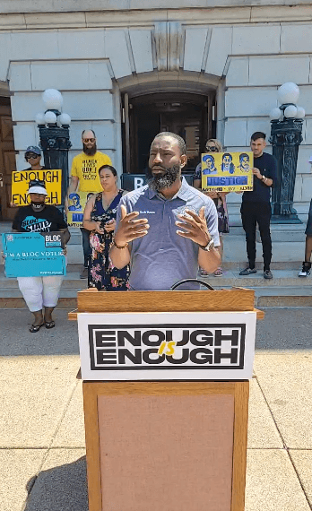 Rep. David Bowen (D-Milwaukee) speaks during the press conference at the capital alongside BLOC, The People's Revolution, and others. Screenshot by Isiah Holmes/Wisconsin Examiner.