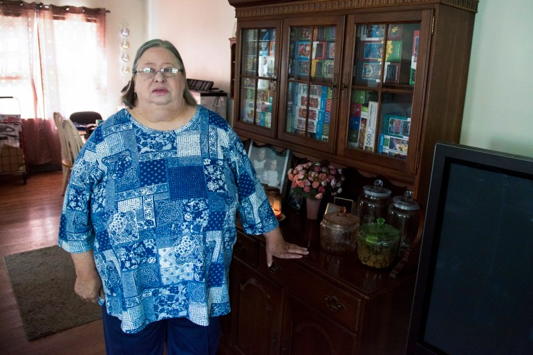 """Karen Miller, 65, tapped into Social Security last year after an 11-week wait for unemployment aid from the Wisconsin Department of Workforce Development forced her to spend down her life savings. The monthly payments from the federal retirement program help, but they fall short in covering her expenses. """"I'm willing to take an entry-level position,"""" she says. """"But they don't want to train somebody that's 65 years old."""" Miller is seen at her home in Rockford, Ill. Credit: Will Cioci / Wisconsin Watch"""