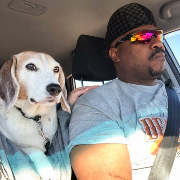 Pierre Young, 51, of Milwaukee is seen with his 15-year-old beagle, Duncan. Young says Duncan used to travel with him to work — when he had a job. Young lost his part-time ministry warehouse job during the pandemic and sold his two aging trucks to make rent. Now his lack of transportation is hindering his work search. Credit: Courtesy of Pierre Young
