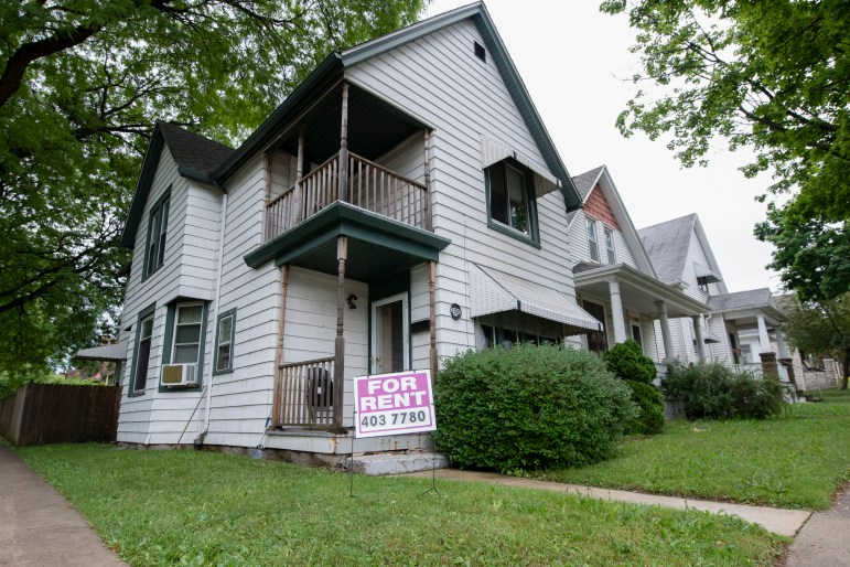 """A """"for rent"""" sign is seen outside of a home on Griffin Street in Milwaukee on June 29, 2021. Several renters say they are struggling to navigate federally funded rental assistance programs offered through Milwaukee County and the city of Milwaukee. Photo by Isaac Wasserman / Wisconsin Watch"""