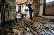 Workers tear down parts of an old kitchen inside of a home before remodeling Thursday, Aug. 5, 2021, in Milwaukee, Wis. Angela Major/WPR