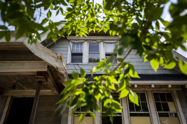 Windows of a home can be seen through leaves Thursday, Aug. 5, 2021, in Milwaukee, Wis. Angela Major/WPR