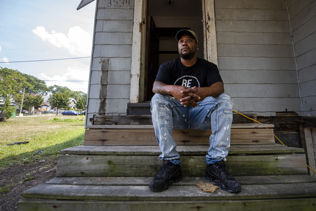 Reginald Reed sits on the steps of a home he's remodeling in a Milwaukee neighborhood Thursday, Aug. 5, 2021. Angela Major/WPR