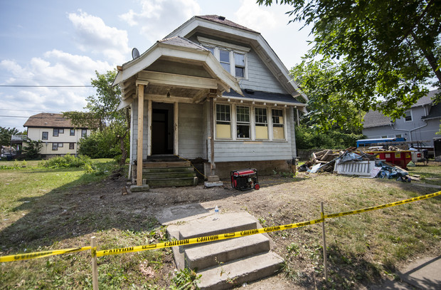 Reginald Reed and his team work on this home Thursday, Aug. 5, 2021, in Milwaukee, Wis. Angela Major/WPR