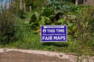 """A yard sign in Mellen, Wisconsin reads: """"This Time Wisconsin Deserves Fair Maps,"""" paid for by the Fair Elections Project, FairMapsWI.com. Photo by Tony Webster from Minneapolis, Minnesota, United States, CC BY 2.0 , via Wikimedia Commons"""