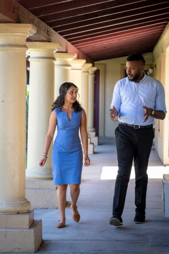 Sukhi Samra, left, executive director of the Stockton Economic Empowerment Demonstration (SEED), talks with then-Mayor Michael Tubbs of Stockton, Calif. Tubbs and Samra helped pilot the SEED income program in Stockton from February 2019 to February 2021. One key finding in Stockton was an increase in full-time employment among recipients across the first year, from 28% to 40% — weakening the common critique that guaranteed income would result in fewer people working. Credit: Photo courtesy of Michael Conti