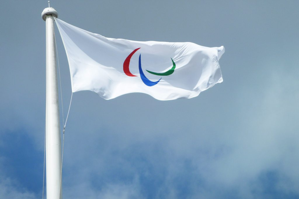 Paralympic Flag. Photo by the The Department for Culture, Media and Sport, CC BY 2.0 , via Wikimedia Commons